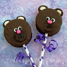 Simple teddy bear treats created from small chocolate cakes then decorated with mini oeros and coloured sweets.