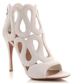 Suede Cut Out Sandals by Alaia. Open toe. Swirl cut out. Ankle high. Zipped back. High heel shoes. Heel measures 4.5in/11.5cm. #Matchesfashion