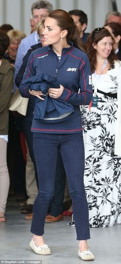 Gifts: Kate is seen holding a sailing jacket that was given to her by well wishers and is emblazoned with her daughter Princess Charlotte's name