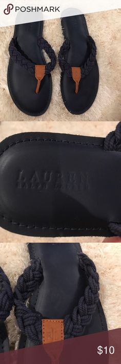 Ralph Lauren flip flops Navy blue flip flops with braided straps and a chestnut colored thong. Small black mark pictured above. Overall good condition. Lauren Ralph Lauren Shoes Sandals