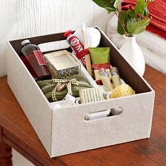Start with a box and dividers. Then customize the contents for each guest, filling with soaps, candles, and small treats. Remember necessities such as face towels or even the Wi-Fi password.