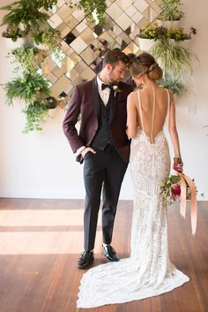 We're loving this groom's style in a burgundy tuxedo next to a gorgeous crystal beaded gown. Photography: Christine Bentley See more here: http://frtx.co/DozN2y
