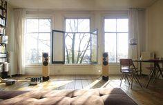 Wooden floor, speakers on it, summer atmosphere. Beautiful space