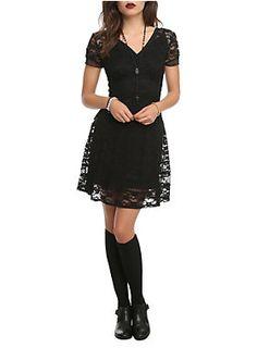 "There is no new black. Black is and forever will be. Royal Bones proves that with this floral lace dress. Black underlay and back zipper closure.<ul><li> 34"" long</li><li>Shell: 90% nylon; 10% spandex</li><li>Trims: 100% polyester</li><li>Hand wash cold; line dry</li><li>Imported</li></ul>"