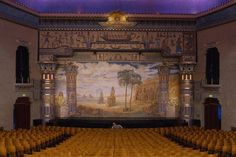Peery's Egyptian Theater, in Ogden, Utah, the ornate stage features a landscape mural.
