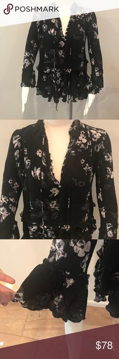 NWOT Free People black floral blouse bell sleeve Brand new without tags! Faded black blouse with a floral print. Bell sleeves and front buttons. Gorgeous top! Free People Tops Blouses