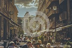 Bucharest, Romania - April 21, 2014: People eat, drink, relax and socialize everyday in sidewalk cafes, bistros and restaurants in the old Lipscani district, the most attractive area for tourists.