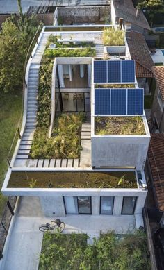 Eco-Friendly House Built Around A Vertical Garden #fachadasverdes