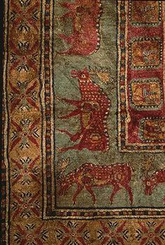 Eastern Altai, 5th - 4th c. BC, wool  The world's most ancient pile carpet was found in the largest of the Pazyryk burial mounds. Its decoration is rich and varied: the central field is occupied by 24 cross-shaped figures, each of which consists of 4 stylized lotus buds. This composition is framed by a border of griffins, followed by a border of 24 fallow deer. The widest border contains representations of work-horses and men.