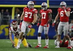 Dec 29, 2017; Arlington, TX, USA; Ohio State Buckeyes defensive lineman Nick Bosa (97) celebrates a sack against USC Trojans quarterback Sam Darnold (14) in the first quarter in the 2017 Cotton Bowl at AT&T Stadium. Mandatory Credit: Tim Heitman-USA TODAY Sports
