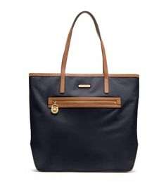 A timeless classic, our Kempton tote is the ideal travel partner thanks to its long shoulder straps and roomy, lightweight nylon body. Plenty of pockets and a zip closure provide organizational ease, while leather trim and gilded hardware are instantly elevating. The perfect carry-on, this must-have will score you frequent style-points for its polished practicality.