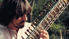 George Harrison (on sitar)