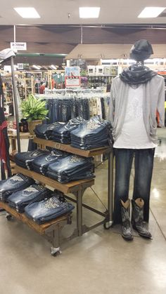 Table full of Miss Me jeans.
