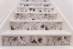 such a cute idea...wallpapered stairs