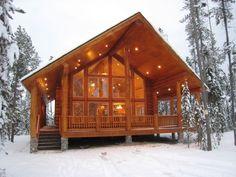 beautiful modern cabin in the snow