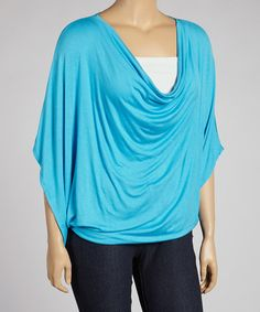 Make it a memorable style moment in this fancy top. Curve-conscious spandex gently hugs the body, crafting a sleek silhouette, while the draped neckline neckline adds a graceful finish.