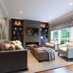 family room with built-in design. fireplace below flat screen.