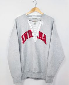 Indiana University Laceup College Sweatshirt - size L ⎽⎽⎽⎽⎽⎽⎽⎽⎽⎽⎽⎽⎽⎽⎽⎽⎽⎽⎽⎽⎽⎽⎽⎽⎽⎽⎽⎽ ◊ One of a kind lace-up reworked sweatshirts ◊ ⟫ Handpicked and carefully tailored in our Chicago studio. ⟫ Items may