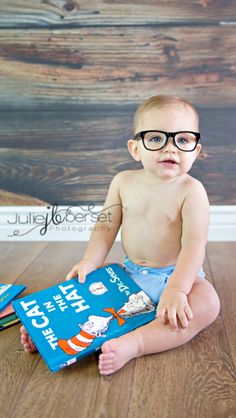 Cutest little nerd you'll ever see! How could you not pin this?! Baby photography cake smash 1 year old birthday reading book glasses