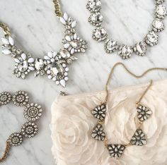 A stunning floral bib necklace with a fresh, eye-catching palette. The ultra-white cabochon and faceted gems contrast beautifully with the clear, crystal sparkle. Perfect for a romantic brunch date an