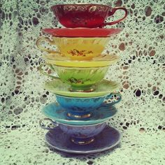 Beautiful rainbow stack of tea cups like chakras.