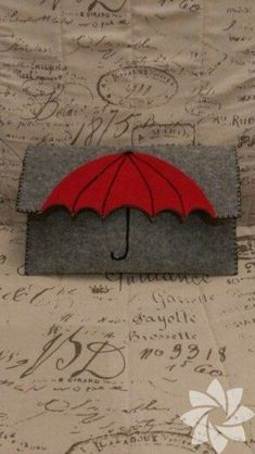 Umbrella felt clutch wallet, could also work as book coverAdorable grey felted clutch purse with red umbrella motif Love the umbrella idea.This Pin was discovered by GorThis is a cute idea that could easily be DIY or just add a little fun in an outfi Felt Wallet, Felt Clutch, Felt Purse, Clutch Purse, Diy Wallet, Purse Wallet, Pouch, Wet Felting, Needle Felting