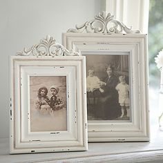 white picture frames.  Limit yourself to just 2 frames on the dresser along with maybe an old alarm clock and a mirror or 2 (large against the wall)