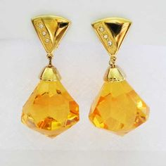 Make an entrance in this pair of vintage clip on drop earrings Beautiful and so big faceted shaped 1980s drops in orange amber with tiny clear diamante