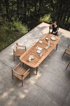 This Teak Outdoor Living Collection Pairs Sustainability and Scandinavian-Inspired Style - Photo 8 of 11 - Inspired by teak decking, and echoing the craftsmanship and design of the Tea Clippers that opened trade routes around the world, Pedersen clearly references his inspiration, using generous deck-like slats, finely tapered legs that hint at a ship's mast—even giving the table a hull-like edge. The Clipper collection is simultaneously a nod to a nautical past, as well as a new take on al…