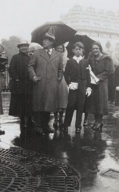 Gertrude Stein, Pablo, Olga and Paulot Picasso at Paulot's first communion.  April, 1934