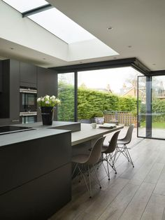 Modern, contemporary kitchen with abstract island in a white and dark grey finish with casual seating and Gaggenau appliances Kitchen Room Design, Modern Kitchen Design, Kitchen Layout, Interior Design Kitchen, Kitchen Ideas, Modern Grey Kitchen, Modern Farmhouse, Contemporary Kitchen Island, Modern Contemporary