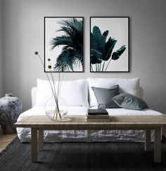 Summer vibes | Scandinavian minimalist living room | white linen sofa | hints of blue | Desanio.com palm tree wall prints | IKEA Söderhamn sofa with a Bemz Loose Fit Urban cover in Absolute White Rosendal Linen