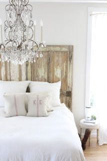 Head Board.  Dreamy Whites created the most beautiful vintage farmhouse look to a bedroom by adding a door headboard.