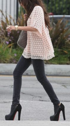skinny jeans and a black heel paired with a pink flowy shirt with graphic pattern.