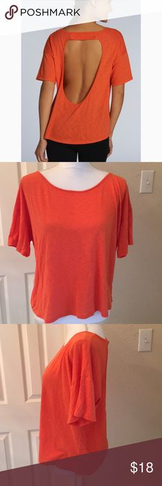 Fabletics Key Tee Open Back Shirt Awesome Fabletics top- full coverage in front and short-sleeves, but has open back.  Comfortable & easy to move in!  See pictures for measurements. Fabletics Tops Tees - Short Sleeve