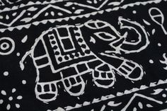 A close up of the kantha embroidery along the elephant print. Entirely handmade. Pretty kantha quilt. #kantha