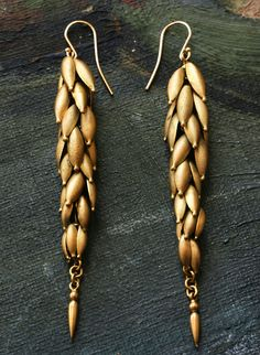 1830s Pinchbeck Seed Pod Drop Earrings,  (sold)  Pinchbeck is an alloy of copper and zinc that was invented in the 18th century to imitate gold.  It's kind of amazing stuff since it really looks and behaves like gold, except that it's much lighter feeling— which in the case of these giant earrings is probably a good thing.