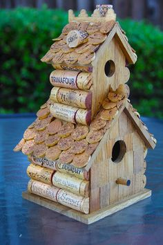 Birdhouse decorated with corks. I have a drawer of corks.
