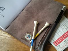 Gift for golfer,Leather Golf Score Cards, Leather golf log,Golfing log, leather golf book, golf gift, personalised golf gift, available in a choice of colours    Give as a lovely gift or record your own golfing prowess!    Made from genuine Spanish leather (choose your colour in the dropdown menu) Hand punched & stitched with a toning  cotton thread,  I think it is the perfect companion to any golfer and would make a great gift.    A golf log / journal / score card- indispensable to…