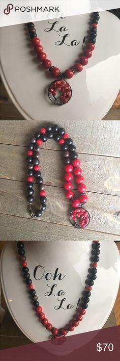 Red Coral and Tiger Ebony Wood Necklace This wood and gemstone necklace is made with natural Red Coral and natural Tiger Ebony beads. It features a beautiful Tree of Life Pendant with Red Coral.   This beautiful stone has several healing properties that are listed in the photos above.  Please Note: The use of gemstones is not meant as a substitute for medical or psychological diagnosis and treatment  Always made with love, light and positive energy! Handmade Jewelry Necklaces