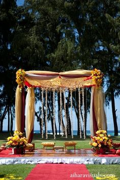 Beautiful Indian wedding ceremony, this couple has a traditional mandap set on the beach in Hawaii!
