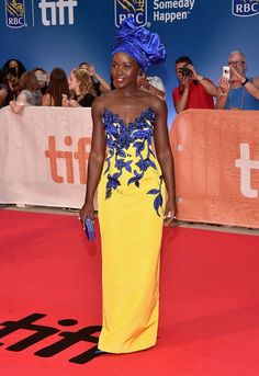 """soph-okonedo: """" Lupita Nyong'o arrives at the world premiere of Disney's """"Queen of Katwe"""" at Roy Thompson Hall as part of the 2016 Toronto Film Festival where the cast, filmmakers and real life stars received a standing ovation """" African Wear, African Attire, African Fashion Dresses, African Dress, Fashion Outfits, Africa Fashion, African Beauty, Black Is Beautiful, Yellow Dress"""