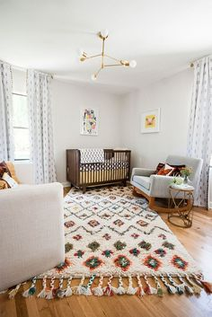 Cozy and stylish Scandinavian nursery with gorgeous rug for added warmth