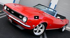 Stunning red 1968 Chevy Camaro SS with convertible top, stylish black interior and 396 Big Block Chevrolet V8 engine, this is one of those awesome muscle cars!