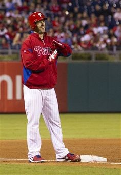 Philadelphia Phillies' Cliff Lee calls for time to catch his breath after hitting his 1st triple against the Miami Marlins during the fifth inning of a baseball game, Monday, Sept. 16, 2013, in Philadelphia. (Cliff, you are to funny