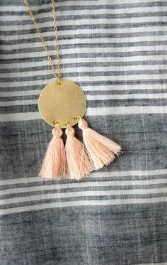 Following the statement earring trend, we are sharing how to make a DIY Gold Tassel Necklace! Add a pop of color with tassels to make the gold shine.