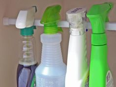 With so many types of cleaning supplies, your kitchen and bathroom cabinet can fill up fast. To keep things more organized, make use of every inch of space by hanging household cleaners from a tension rod, saving space on the shelves for other everyday items.