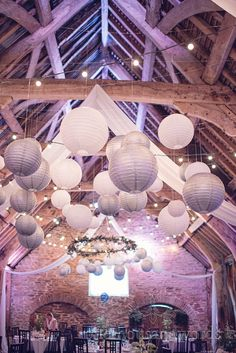 Silver and white chinese lanterns at Barn wedding venue in Dorset. Photography by one thousand words wedding photographers
