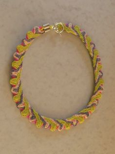 Apple Blossom. Ply Split braided necklace. £65. Braided Necklace, Fabric Design, Macrame, Braids, Weaving, Necklaces, Apple, Craft, Jewelry