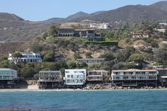 Beyonce's Malibu home that used to belong to Cher (Malibu) These are all some pretty sweet Malibu beach homes, but Cher's takes the cake. It's the giant brown one situated in the center of the picture, high above the others, on the bright-green grass.